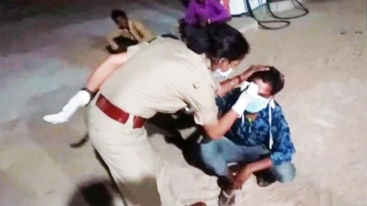 'ഞാന് ലോക്ഡൗൺ ലംഘിച്ചു'; കുടിയേറ്റ തൊഴിലാളിയുടെ നെറ്റിയിൽ ചാപ്പകുത്തി പൊലീസ് VIDEO
