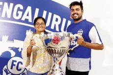 meghana-and-suraj-nair-with-isl-trophy