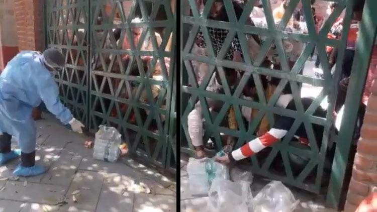 യു.പിയിൽ ക്വാറന്റീനിലുള്ളവർക്ക് ഭക്ഷണം എറിഞ്ഞ് കൊടുക്കുന്നു; 'സാമൂഹിക അകലം' മറന്ന് തിരക്ക് VIDEO